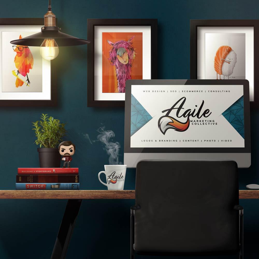 Mug of coffee on a desk with Agile logo on computer screen