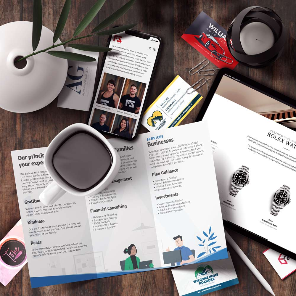 A selection of digital marketing work laid out on a desk