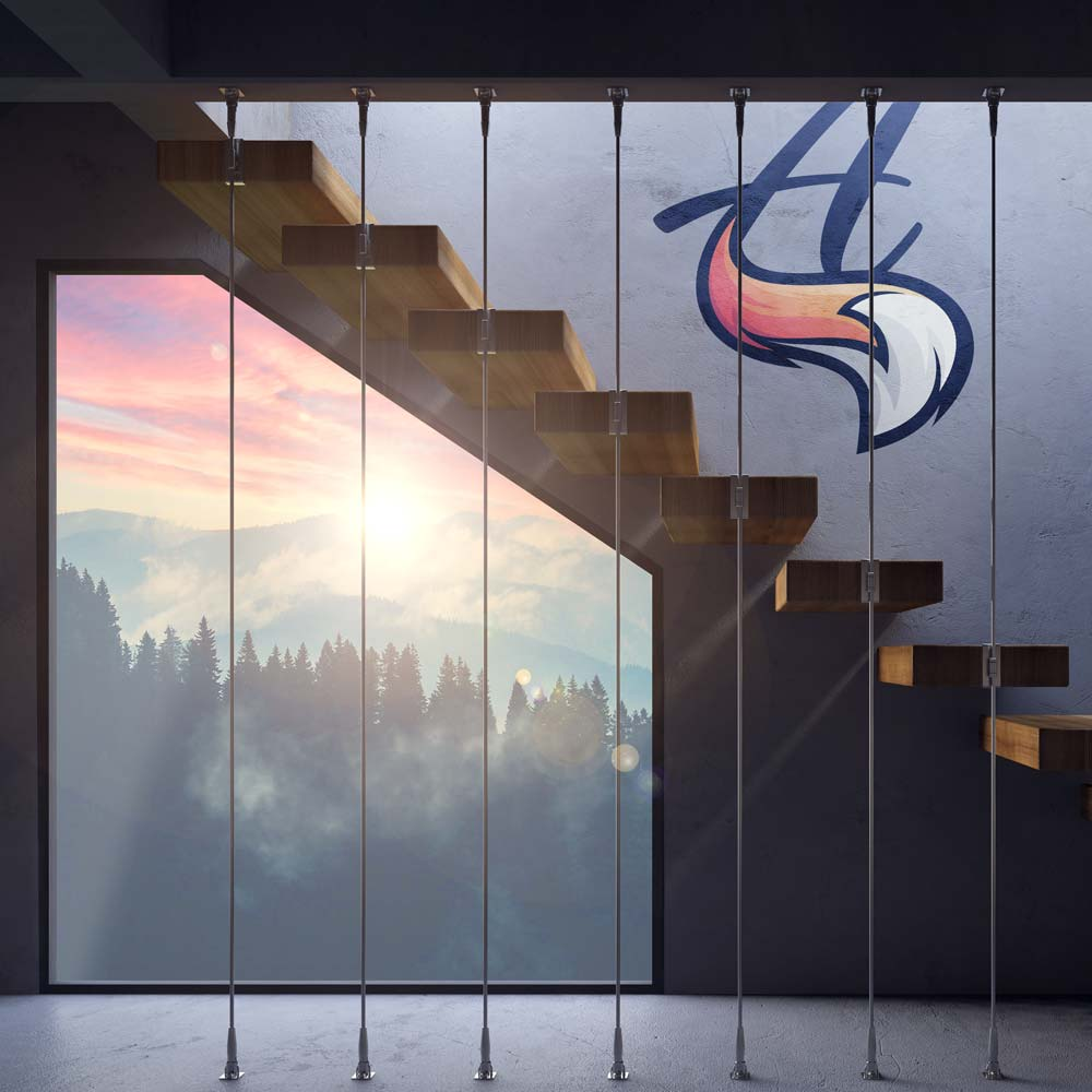 A staircase in front of a window with a beautiful view of the mountains